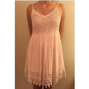 Cream colored lacy dress.